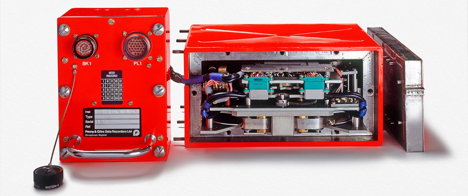 PHOTO: Front views of flight data recorder, with cover on and with cover removed.