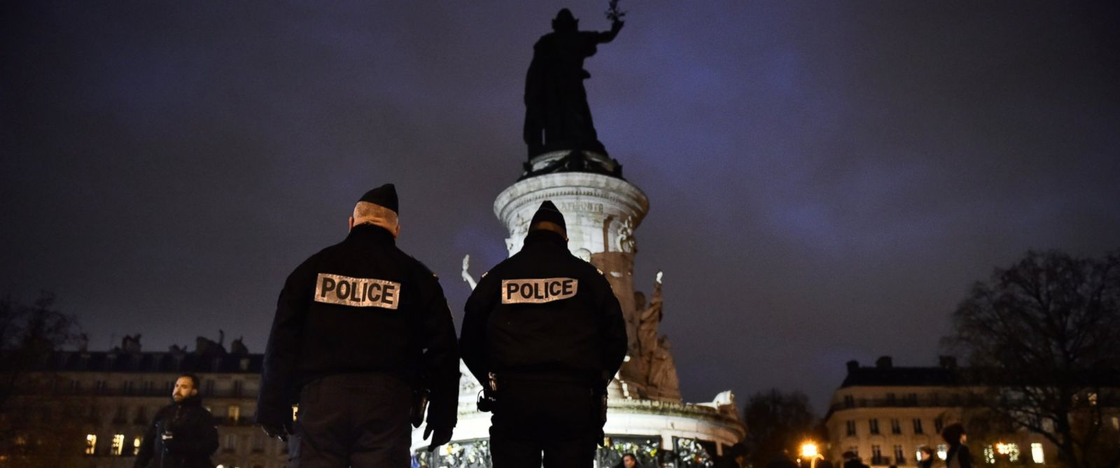 PHOTO: French police officers stand guard at Place de la Republique (Republic Square) in Paris on Nov. 21, 2015 as people gather to pay tribute to the victims of the Nov. 13th terror attacks.