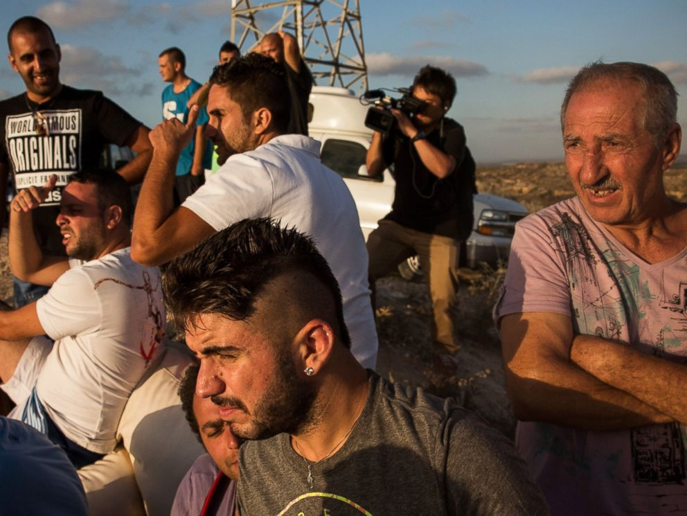PHOTO: Civilians and members of the media wait to see Israeli attacks inside Gaza from the top of a hill on the sixth day of Israels operation Protective Edge on July 13, 2014 in Sderot, Israel.