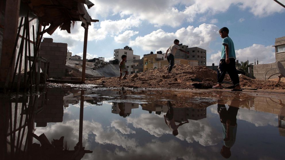 PHOTO: Palestinians inspect a house destroyed in air attacks staged by the Israeli army in Gaza City, Gaza, July 14, 2014.
