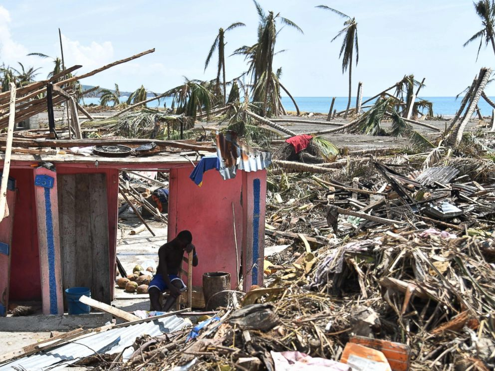 PHOTO: A man sits next to his destroyed house in Les Cayes, Haiti, Oct. 10, 2016, following the passage of Hurricane Matthew.