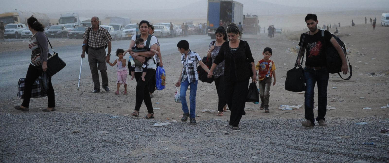 PHOTO: Thousands of Yazidi and Christian people flee Hamdaniyah town for Erbil after the latest wave of ISIL advances has seen a number of towns near Iraqs second largest city Mosul fall to the militants on Aug. 6, 2014.