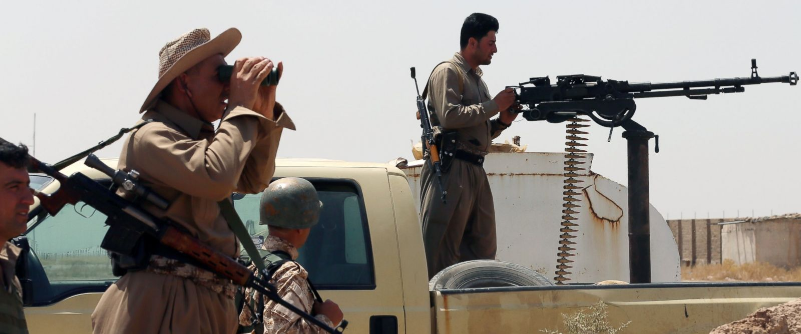PHOTO: Iraqi Kurdish forces take position as they fight jihadist militants from the Islamic State of Iraq and the Levant (ISIL) on June 29, 2014 in the Iraqi village of Bashir (Basheer), 20 kilometers south of the city of Kirkuk.
