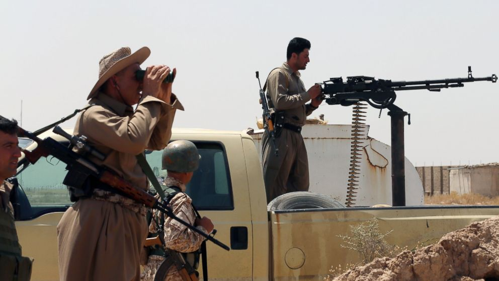 PHOTO: Iraqi Kurdish forces take position as they fight jihadist militants from the Islamic State of Iraq and the Levant (ISIL) on June 29, 2014 in the Iraqi village of Bashir (Bas