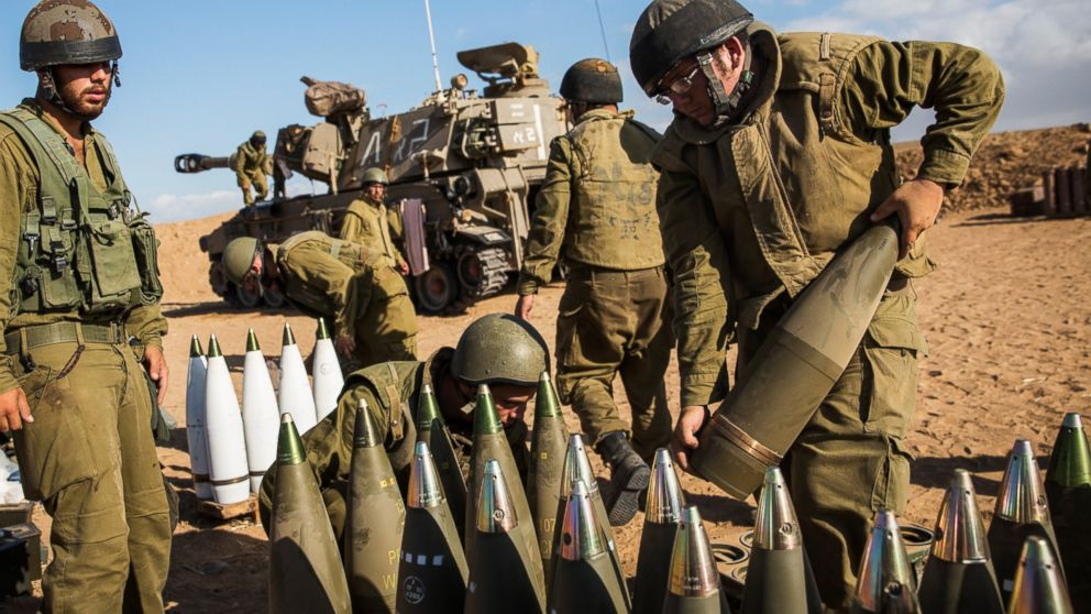 PHOTO: Israeli soldiers organize artillery shells for firing into Gaza, July 17, 2014, near Sderot, Israel.