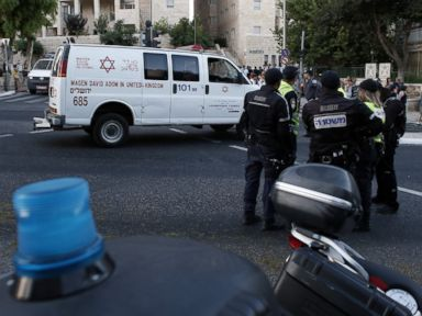 PHOTO: Israeli police cordon off the site where Yishai Shlissel, an ultra-orthodox Jew, stabbed six people taking part in a Gay Pride march in central Jerusalem on July 30, 2015.