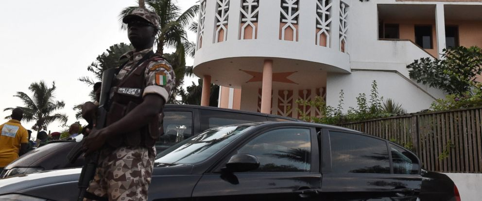 PHOTO: rian soldier stands guard in front of the Etoile du Sud, one of the hotels attacked by heavily armed men on March 13, 2016 in the Ivory Coast beach resort of Grand-Bassam.