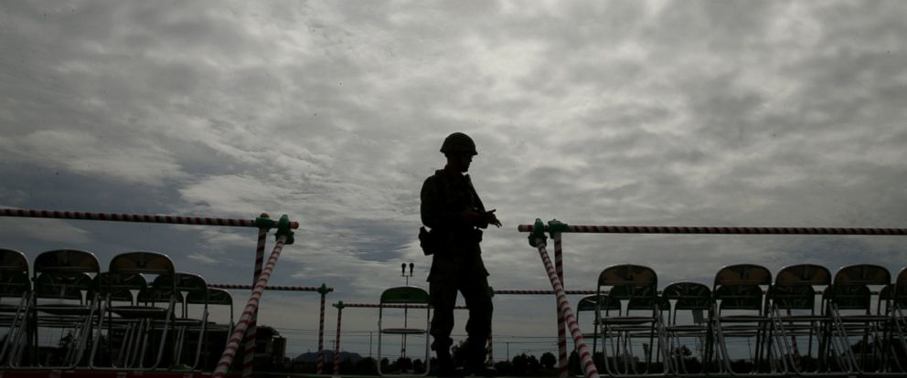 PHOTO: A Japan Ground Self-Defense Force (JGSDF) officer stands as typhoon Phanfone rainstorm darkens the sky during the annual Japan Ground Self-Defense Force military demonstration on Oct. 5, 2014 in Himeji, Japan.