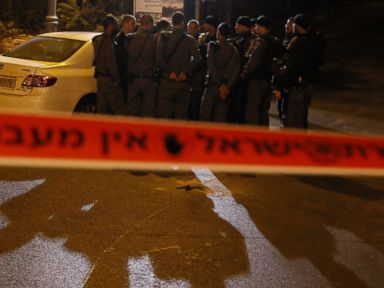 PHOTO: Israeli security forces gather behind a security perimeter outside the Menachem Begin Heritage Center where a Jewish activist was wounded during a shooting on Oct. 29, 2014 in Jerusalem.
