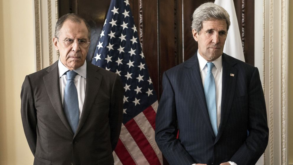 PHOTO: Russian Foreign Minister Sergey Lavrov, left, and U.S. Secretary of State John Kerry, right, stand together before a meeting at Winfield House in London, England on March 14, 2014.