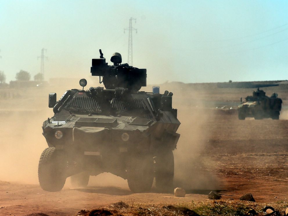 PHOTO: Turkish army patrols near the Turkish-Syrian border area near the Syrian town of Ain al-Arab, known as Kobani by the Kurds, in the southeastern town of Suruc, Turkey, Oct. 7, 2014.