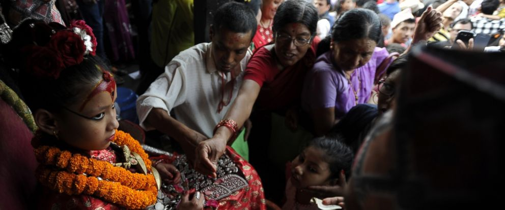 PHOTO: The Kumari, considered a living goddess, attends festivities on the last day of the Rato Machindranath chariot festival, also known as Bhoto Jatra, in Jwalakhel on the outskirts of Kathmandu, July 29, 2016.