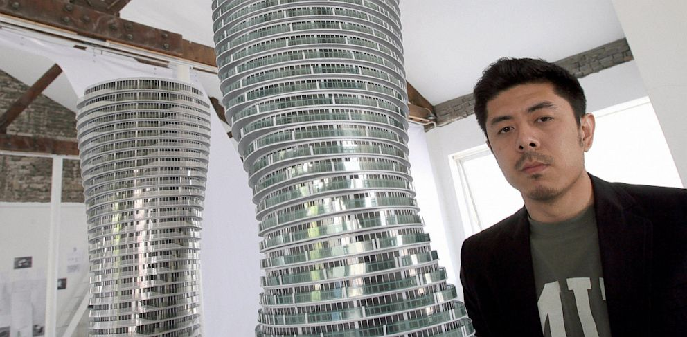 PHOTO: Chinese architect Ma Yansong poses next to his Marilyn Monroe Buildings models