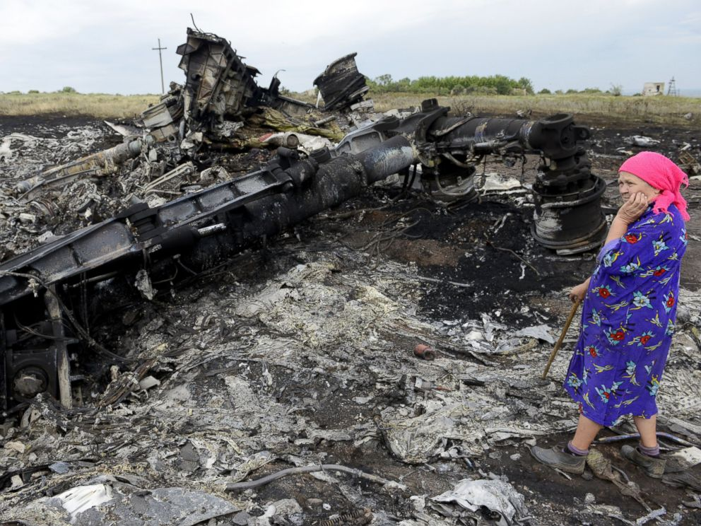 PHOTO: A local resident stands among the wreckage at the site of the crash of a Malaysia Airlines plane carrying 298 people from Amsterdam to Kuala Lumpur in Grabove, in rebel-held east Ukraine, on July 19, 2014.