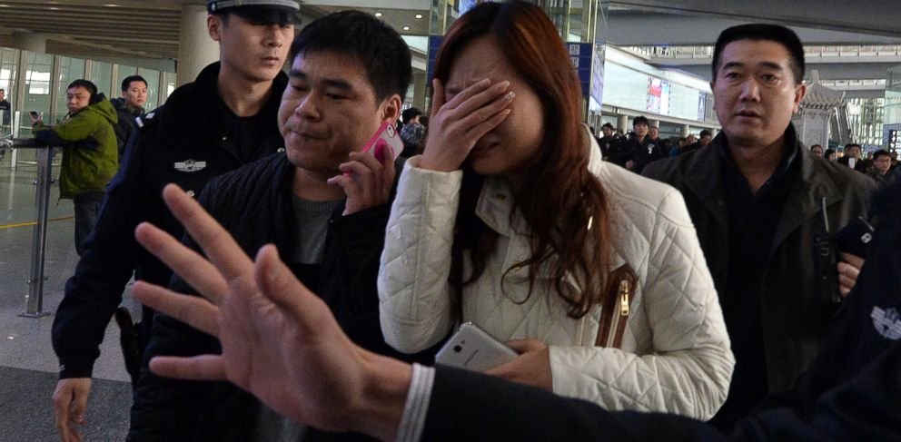 PHOTO: A possible relative cries at the Beijing Airport after news of the missing Malaysia Airlines Boeing 777-200 plane in Beijing, March 8, 2014.