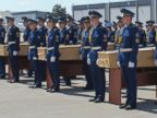 PHOTO: Honor guards take part in a ceremony with coffins of some of the victims of Malaysia Airlines MH17, before they are loaded onto a transport plane heading to the Netherlands at Ukraines Kharkiv International Airport on July 23, 2014.