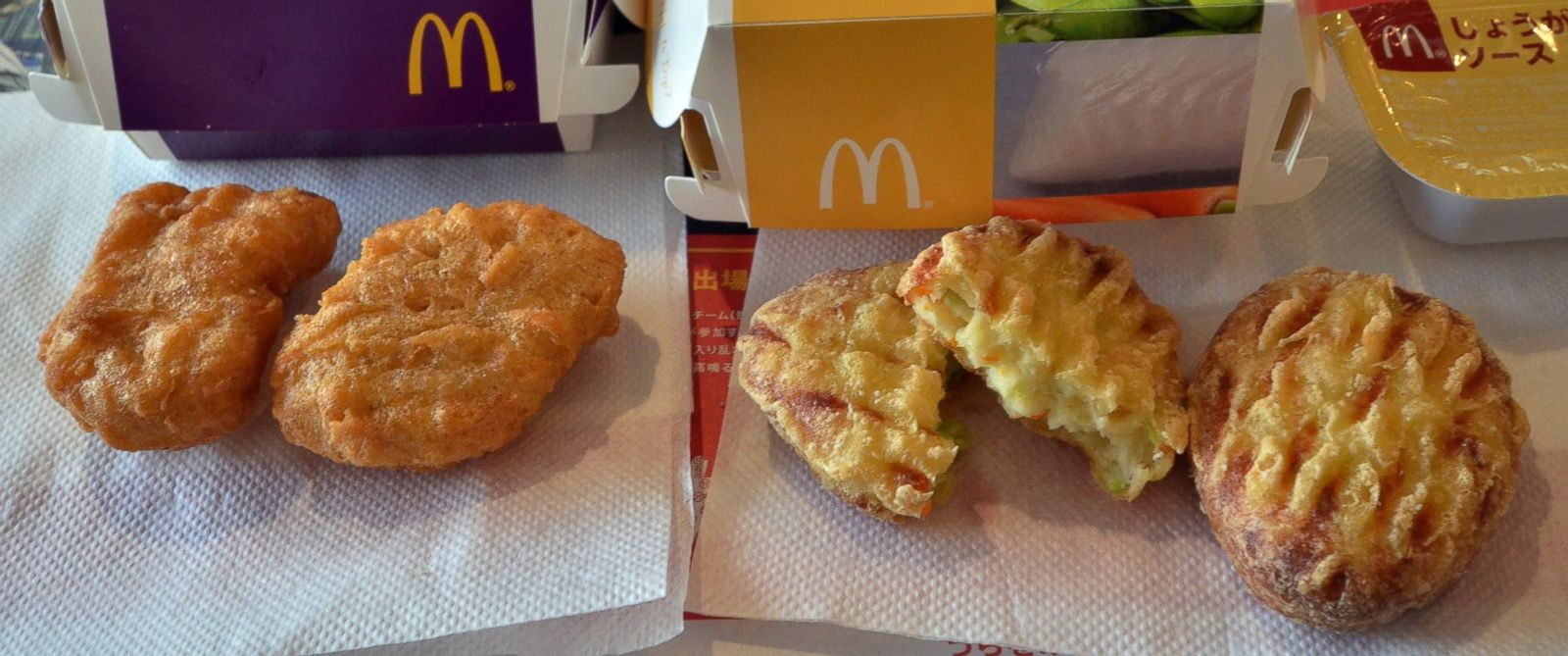 PHOTO: Tofu Shinjo Nuggets, right, and Chicken McNuggets, left, are displayed at a McDonalds restaurant in Tokyo on July 30, 2014.
