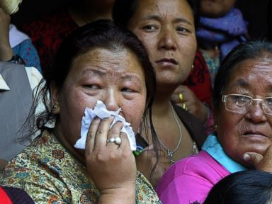 PHOTO: Relatives of a Mount Everest avalanche victim grieve during a cremation ceremony in Kathmandu on April 21, 2014.