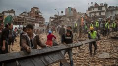 PHOTO: Emergency rescue workers clear debris in Basantapur Durbar Square while searching for survivors on April 25, 2015 in Kathmandu, Nepal.