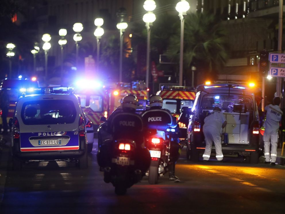 PHOTO: Police officers and rescue workers arrive at the scene of an attack, July 14, 2016, after a van ploughed into a crowd leaving a fireworks display in the French Riviera town of Nice.