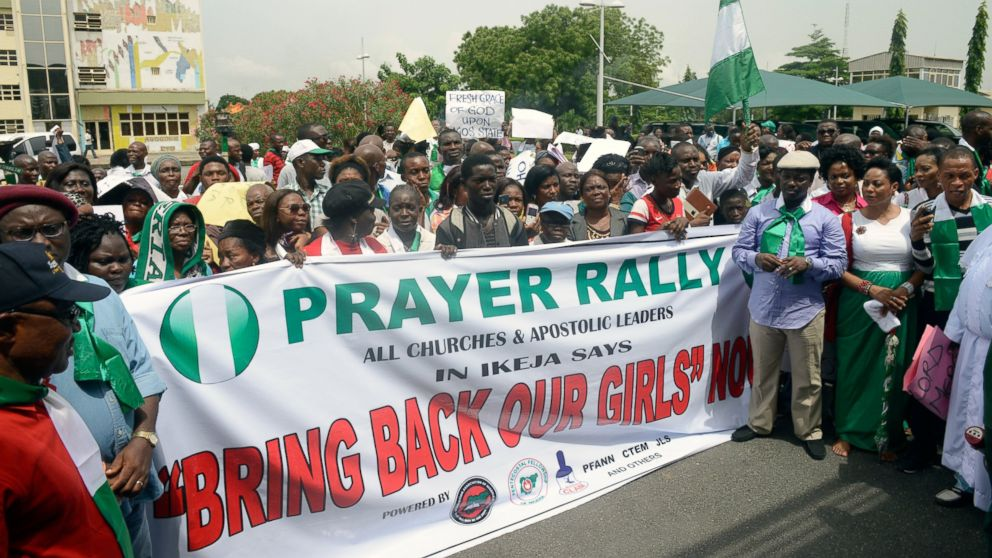 PHOTO: Christian groups carry a banner as they take part in a demonstration to press for the release of missing Chibok school girls in Lagos, M