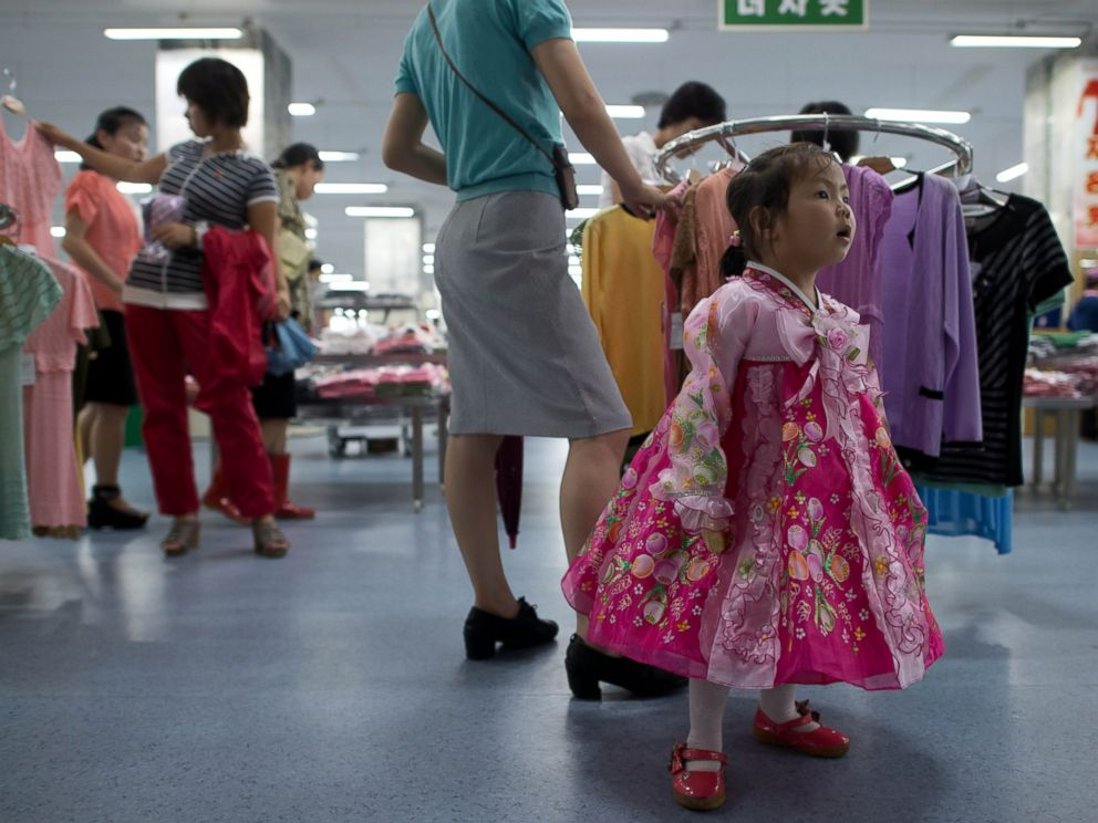 PHOTO: A North Korean girl wearing traditional dress stands at a clothing section inside a supermarket in Pyongyang, North Korea on July 28, 2013.
