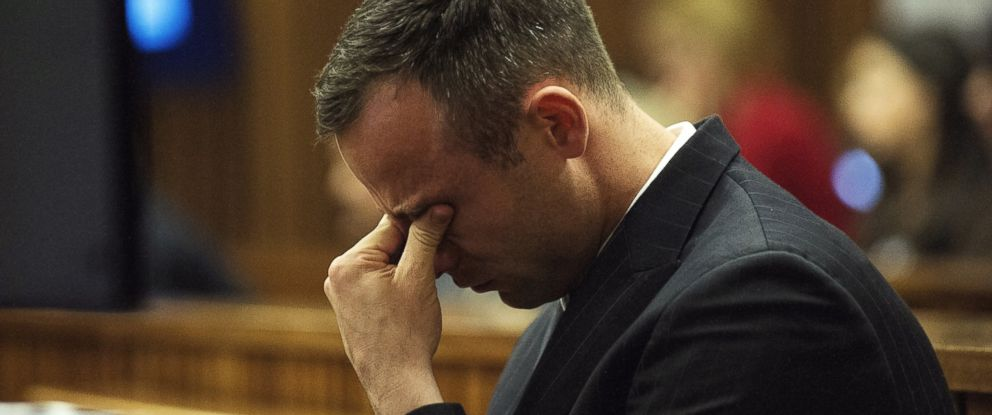 PHOTO: South African Paralympic track star Oscar Pistorius reacts during his trial at the North Gauteng High Court on April 16, 2014 in Pretoria.