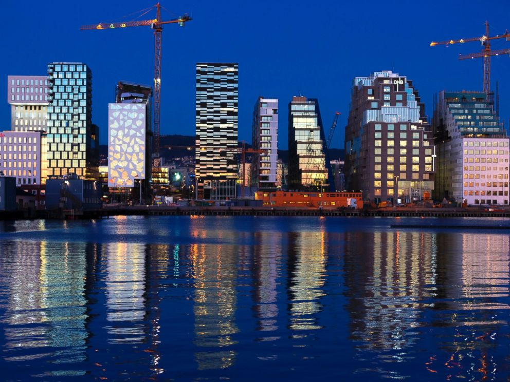 PHOTO: Buildings of The Barcode Project are reflected on the water at sunset in Oslo, Nov. 18, 2012.
