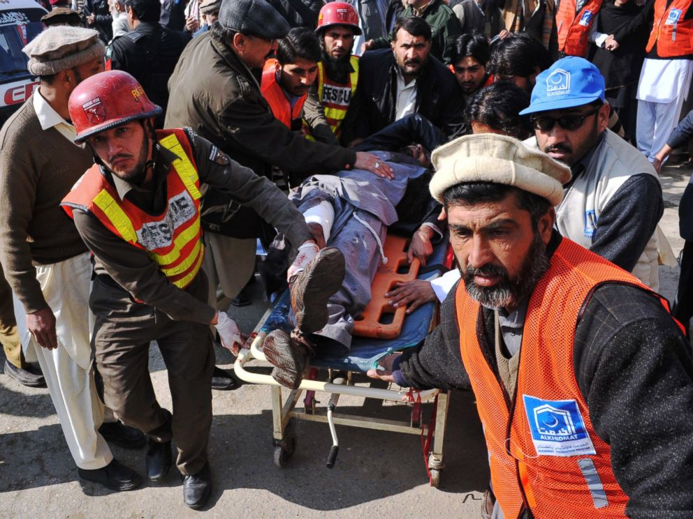 PHOTO: Pakistani rescuers shift an injured man to a hospital following an attack by gunmen in the Bacha Khan university in Charsadda, Peshawar, Jan. 20, 2016.