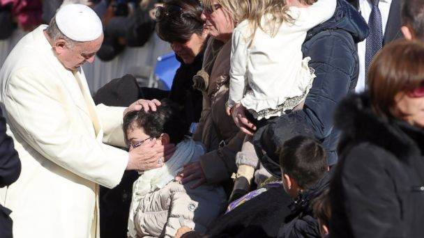 PHOTO: Pope Francis greets disabled people as he leaves St. Peters square at the end of his weekly audience, Dec. 4, 2013, in Vatican City.