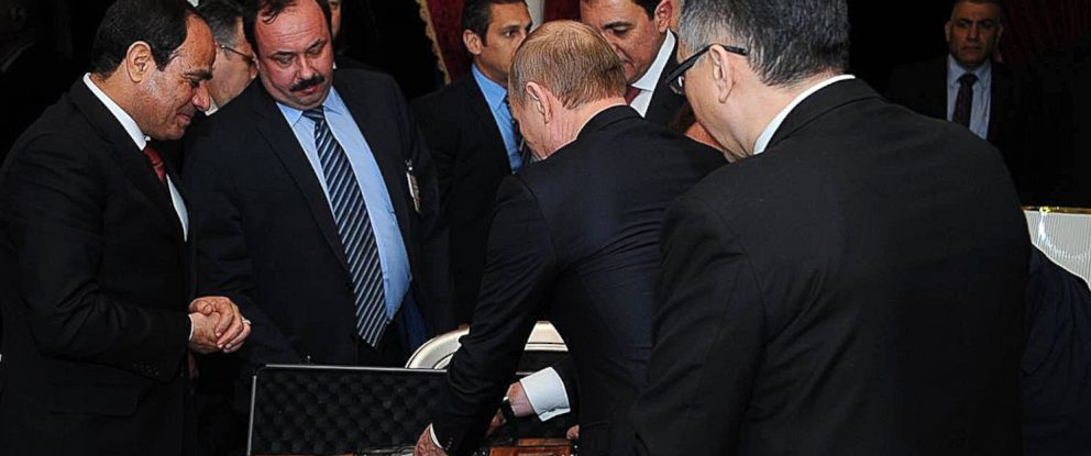PHOTO: Russian President Vladimir Putin gives an AK-47 rifle as a gift to Egyptian President Abdel Fattah el-Sissi during an informal dinner in honor of Putin at Cairo Tower, Feb. 9, 2015, in Cairo.