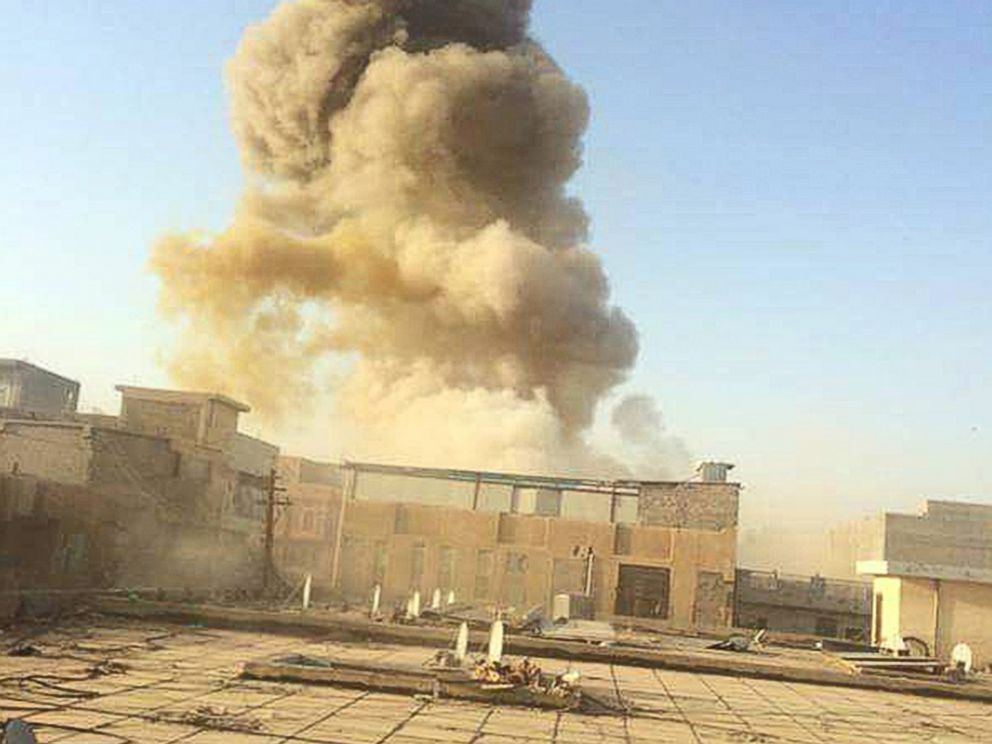 PHOTO: An Islamic State car bomb explodes at the gate of a government building near the provincial governors compound in Ramadi, Iraq, on Saturday, May 16, 2015, during heavy fighting that saw most of the city fall to the militants.