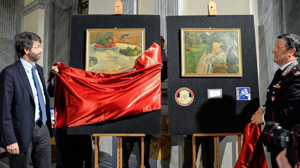"PHOTO: Dario Franceschini, left, and Mariano Mossa unveil Paul Gauguins ""Fruits sur une table ou nature au petit chien"", (L) and Pierre Bonnards ""La femme aux deux fauteuils,"" April 2, 2014."