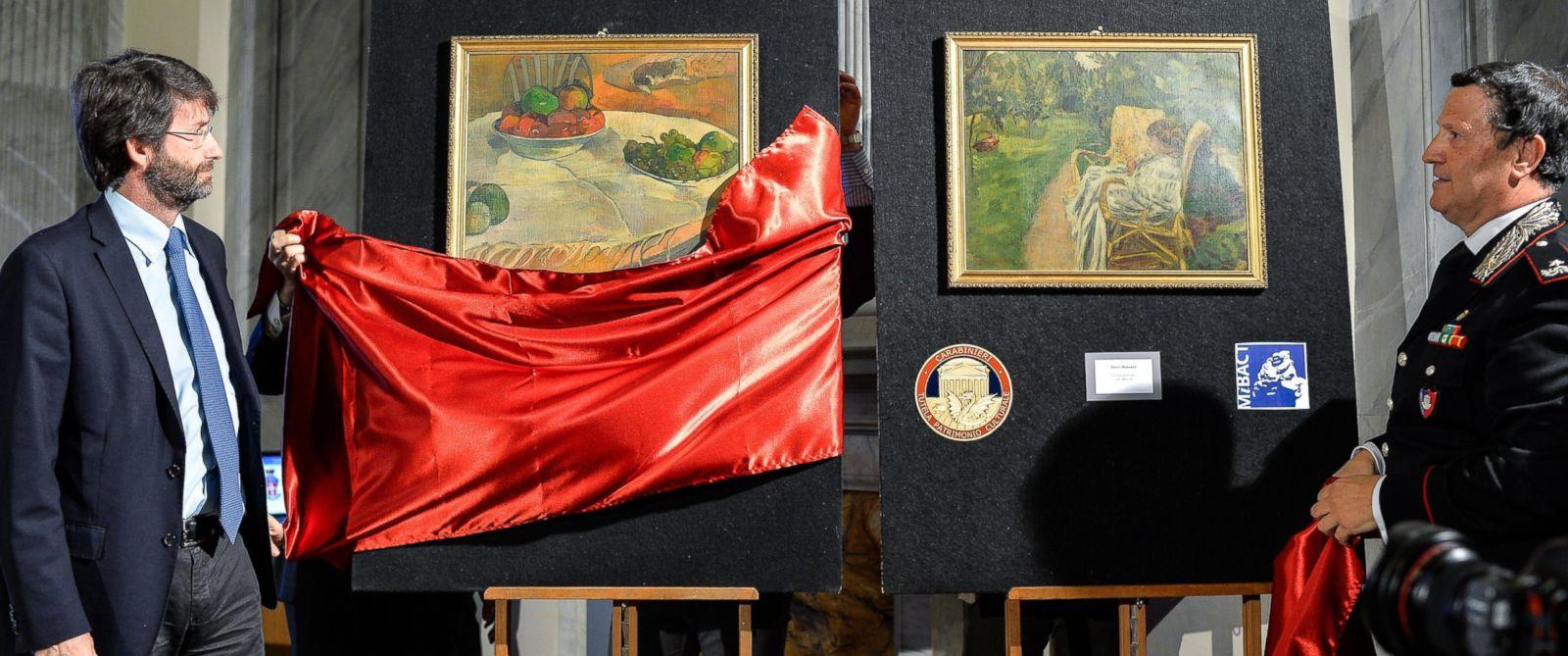 """PHOTO: Dario Franceschini, left, and Mariano Mossa unveil Paul Gauguins """"Fruits sur une table ou nature au petit chien"""", (L) and Pierre Bonnards """"La femme aux deux fauteuils,"""" April 2, 2014."""