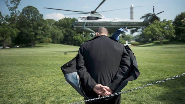 PHOTO: A Secret Service agent ducks rotor wash as Marine One lands on the South Lawn of the White House, May 29, 2013, in Washington.