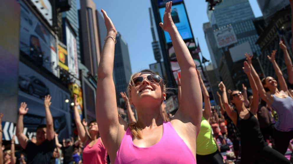 PHOTO: Participants practice yoga as part of a series of mass yoga classes in Times Square