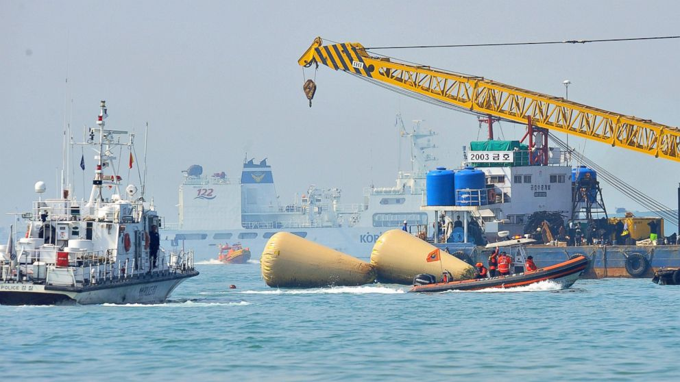PHOTO: South Korean rescue teams take part in recovery operations at the site of the sunken Sewol ferry, marked with buoys, off the coast of the