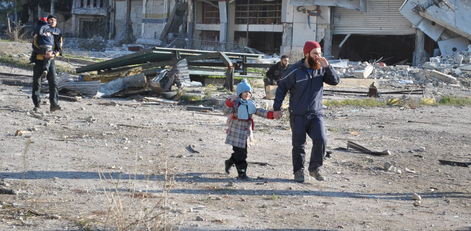 PHOTO: Civilians walk towards an evacuation point in the besieged Syrian city of Homs ahead of an evacuation operation led by the UN, on Feb. 9, 2014.