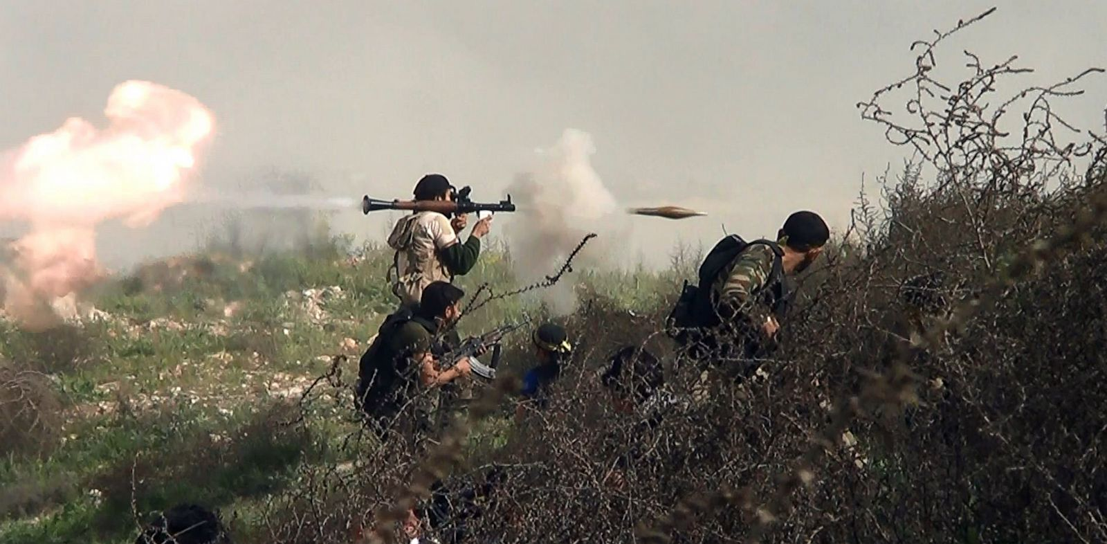 PHOTO: An image grab taken from a video shows an opposition fighter firing a rocket propelled grenade (RPG), Aug. 26, 2013, during clashes with regime forces over the strategic area of Khanasser, situated on the only road linking Aleppo to central Syria.