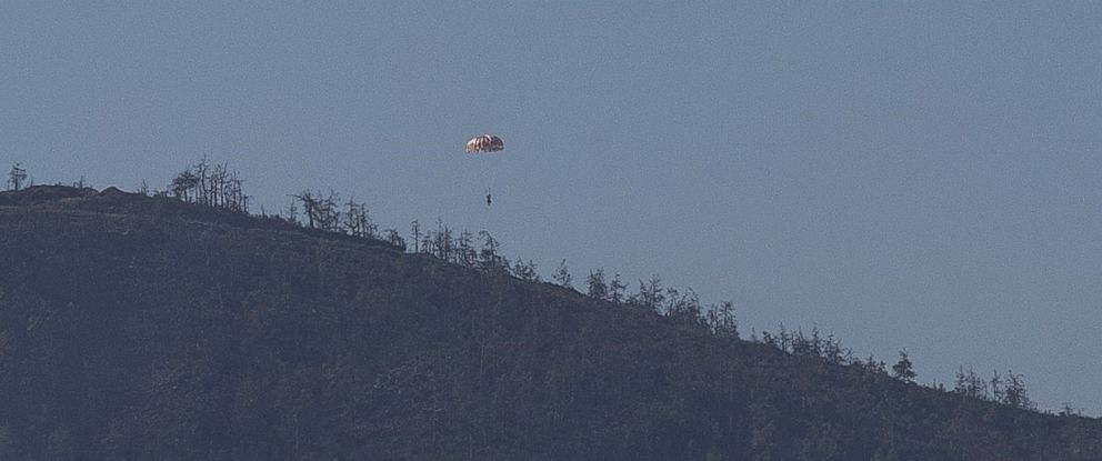 PHOTO: A Russian pilot parachutes out of a warplane which went down in Syrias northwestern Turkmen town of Bayirbucak near Turkeys border, Nov. 24, 2015.