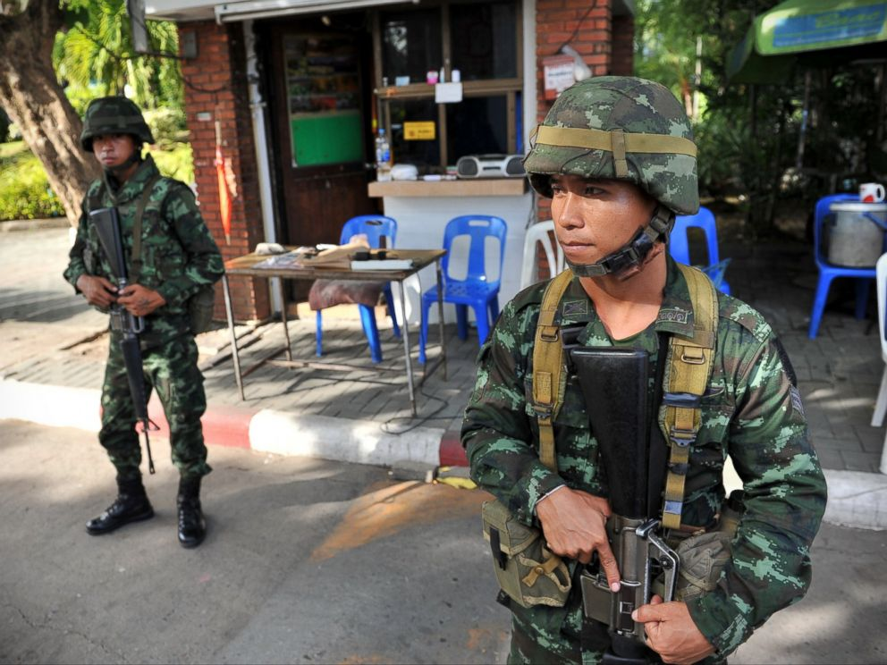 PHOTO: Thai army soldiers stand guard outside the National Broadcasting Services of Thailand after martial law was declared on May 20, 2014 in Bangkok, Thailand.
