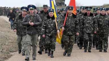 PHOTO: Ukrainian air force pilots march in their air base in Belbek, near Sevastopol, on March 4, 2014.