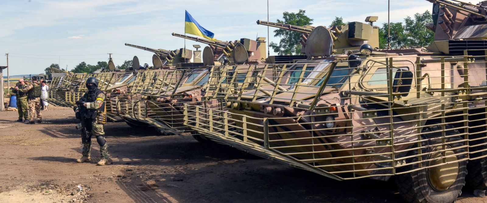 PHOTO: Servicemen guard a parking of APCs (armoured personnel carriers) in headquarters of Ukrainian forces near Izyum, in the Kharkiv region of Ukraine, July 16, 2014.