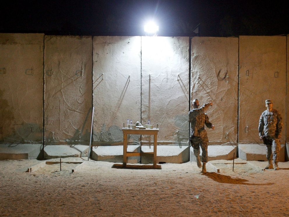 PHOTO: U.S. soldiers throw horse shoes while protected by blast walls from insurgent attacks at the American Embassy, Feb. 6, 2007, in Baghdad, Iraq.