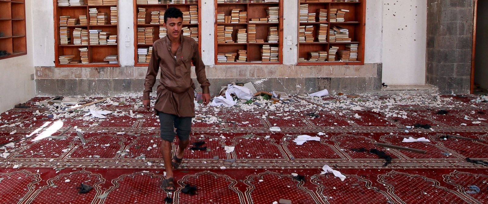 PHOTO: A Yemeni man inspects the damage following a bomb explosion at the Badr mosque in southern Sanaa, Yemen on March 20, 2015.