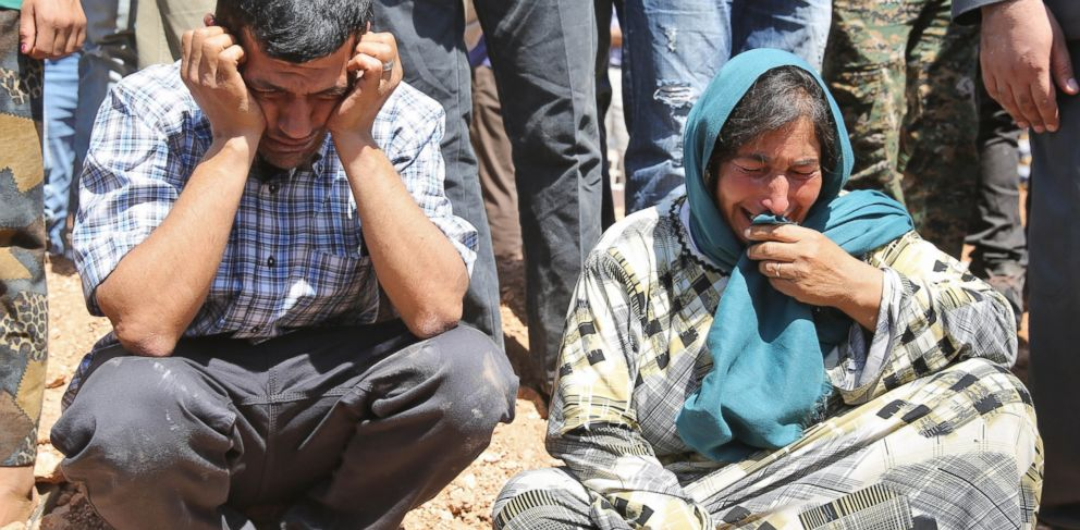 PHOTO:Abdullah Kurdi mourns during funeral of his family, Sept. 4, 2015, in the Syrian border town of Kobani.
