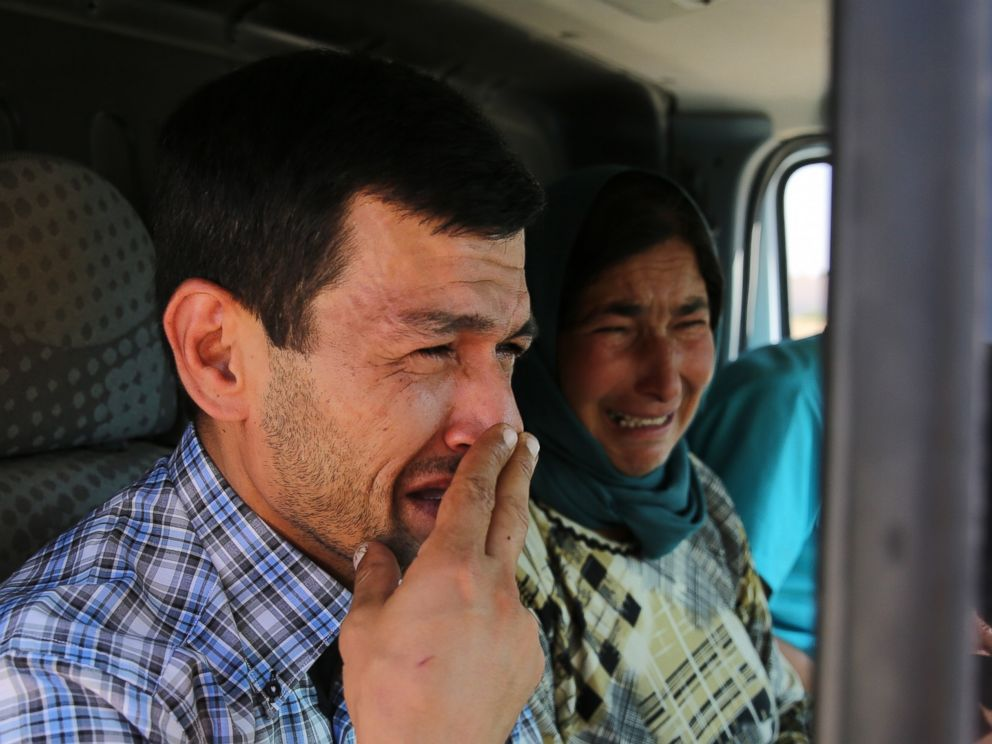 PHOTO:Abdullah Kurdi, father of Syrian children Aylan, 2, Galip, 3, and husband of Rehan Kurdi, 27, cries on his way to the Syrian border town of Kobani to hold funeral of his family, Sept. 4, 2015.
