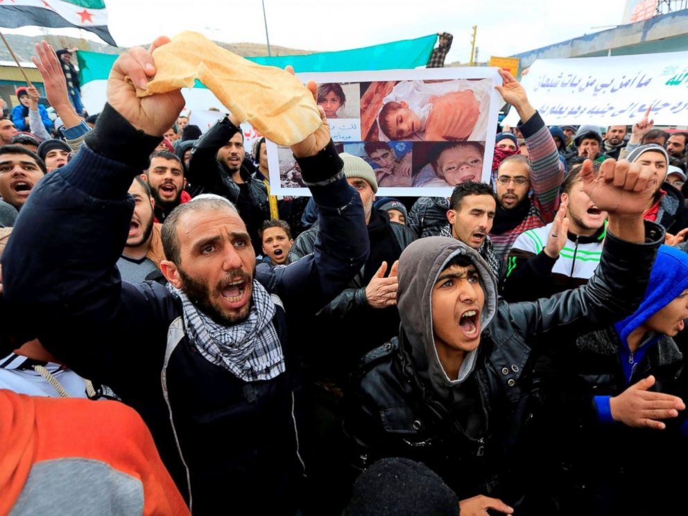 PHOTO: Demonstrators holding breads chant slogans against Syrian regime and Hezbollah, during a protest remarking the humanitarian crisis in Syrias Madana town, on Jan. 8, 2016 in Beqaa, Lebanon.