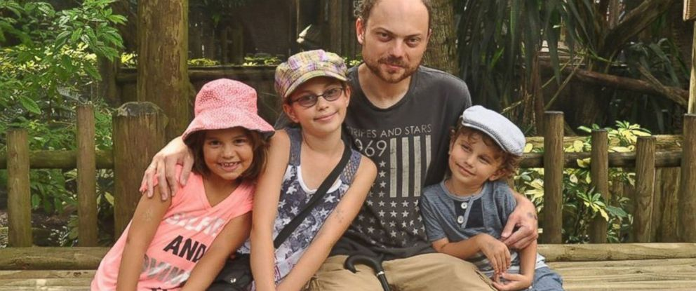 PHOTO: Poisoned Russian Activist Vladimir Kara-Murza, seen with his children in this undated family photo, is fighting for his life in a Moscow hospital Monday night, his wife told ABC News.