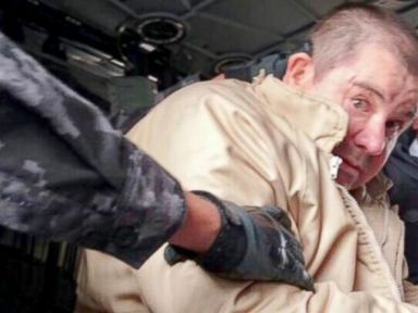 PHOTO: Joaquin El Chapo Guzman is seen being led by authorities for his extradition to the U.S.